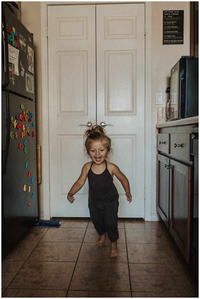 little girl running around home