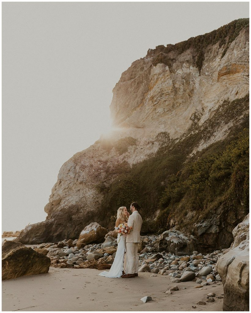 Bridal portraits, intimate moment on beach after saying I do.