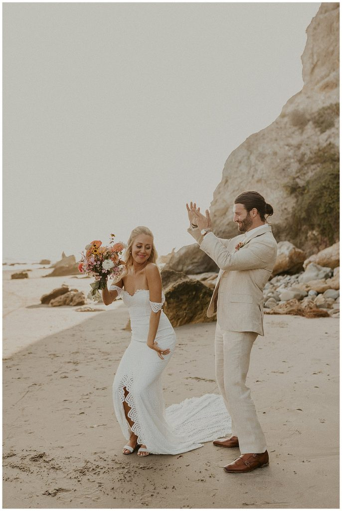Newly married couple dancing and celebrating saying I do!