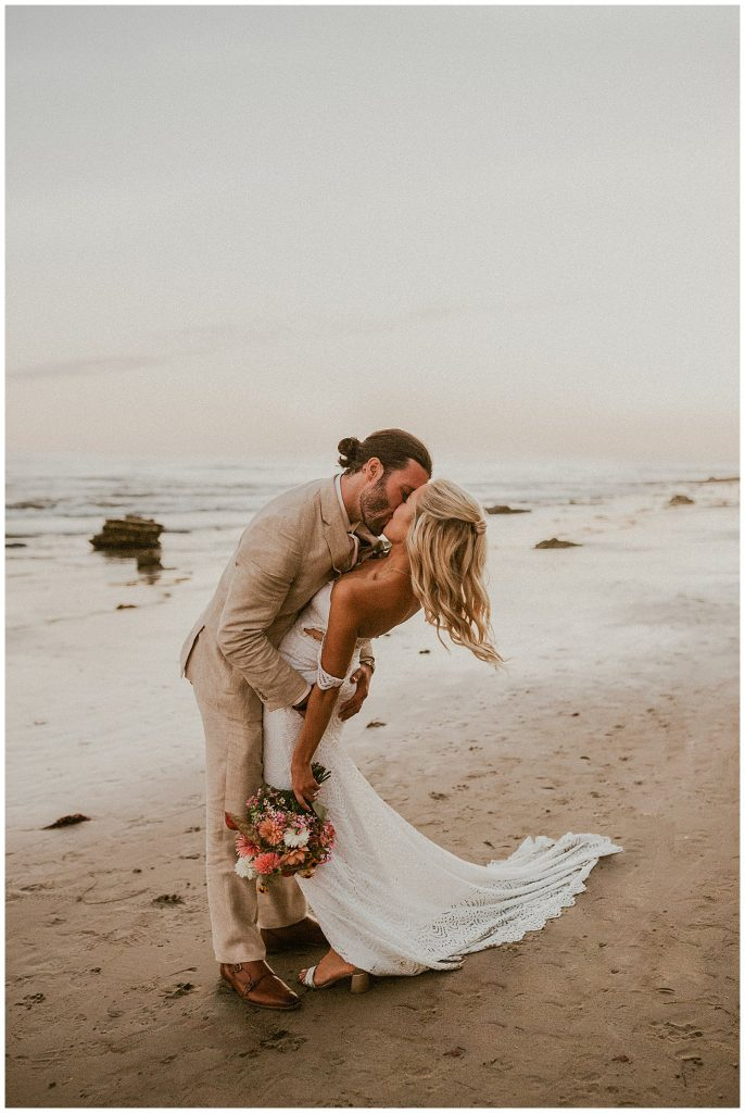 Groom kissing his new bride and dipping her.