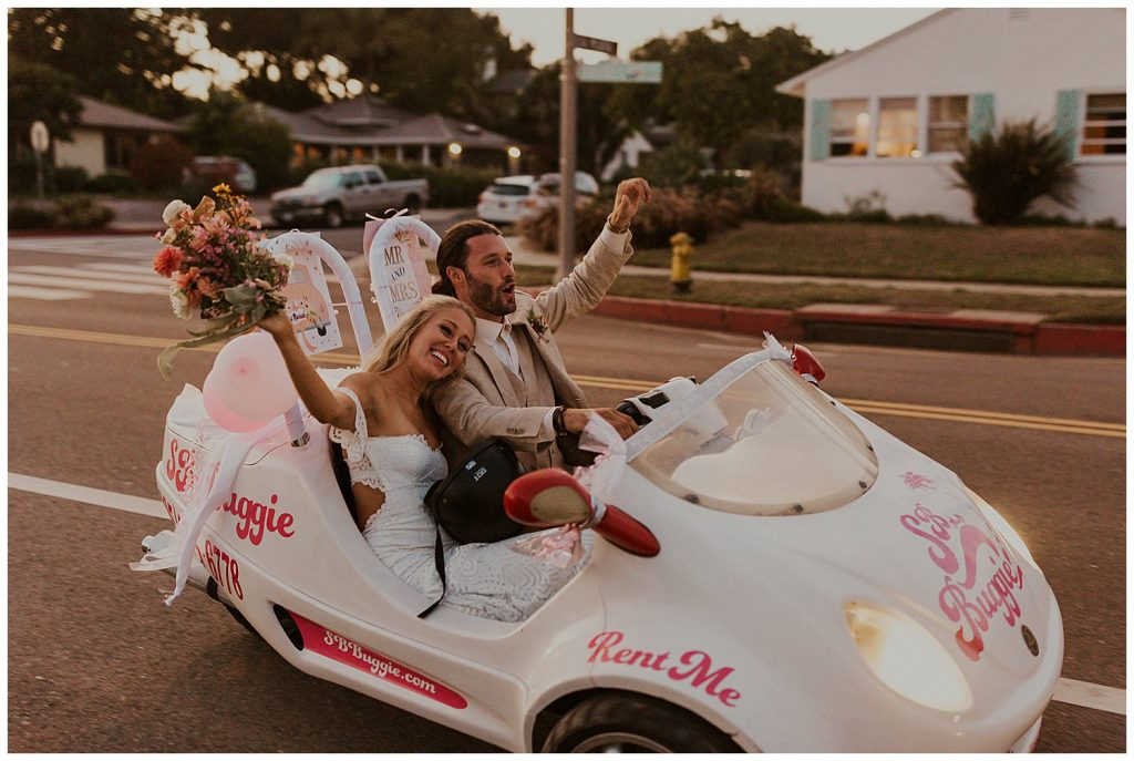 Couple drives away from elopement in SB Buggie with Just Married sign.